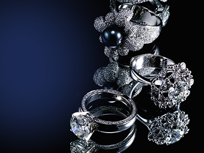 A collection of diamond rings on a plain blue background.