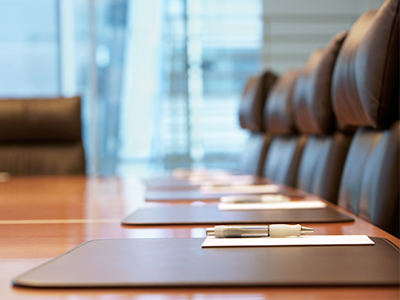 A close-up of boardroom chairs ready for a meeting.